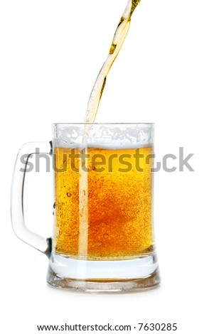 Pouring beer into mug isolated over a white background