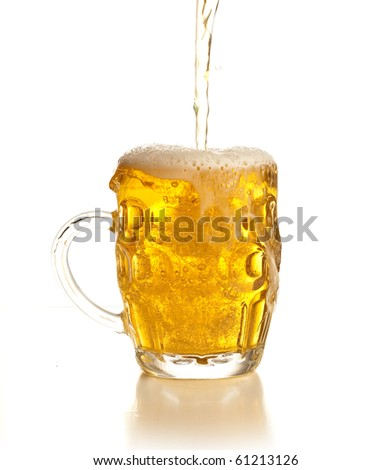 pouring beer on a glass