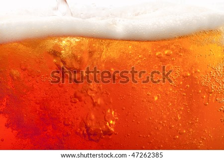 pouring beer with froth. super large flat background