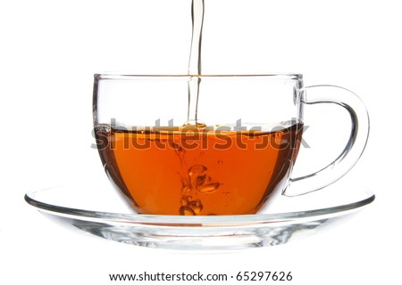 Pouring Black Tea into Glass Cup Isolated on White