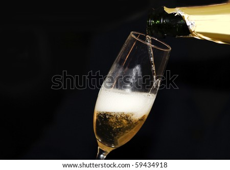 Pouring champagne in a champagne flute