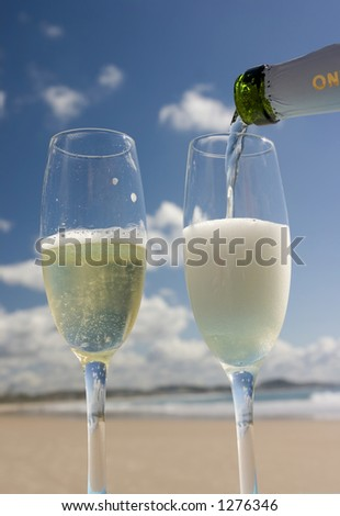 Pouring champagne on the beach