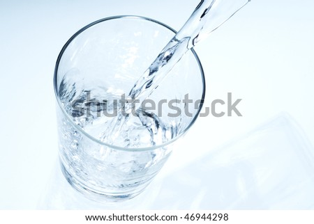 pouring clear water into a glass