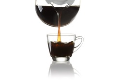pouring coffee into glass from a jar isolated on white background.with clipping path