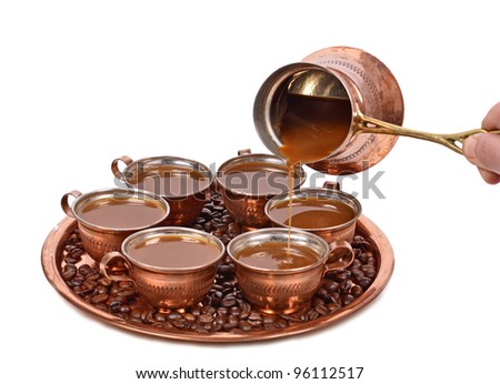 pouring coffee on a cup,copper cups , on a white background