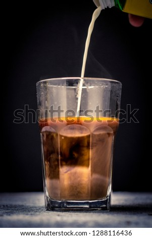 Coffee and milk pour and spill Images and Stock Photos