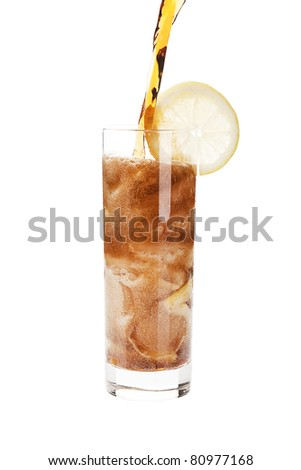 Pouring coke into a glass isolated on white background with clipping path.