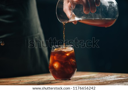 Pouring cold brew coffee Photo stock ©