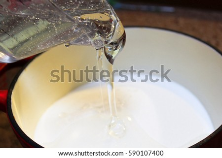 Pouring Corn Syrup into a Pot to Make Hard Candy.