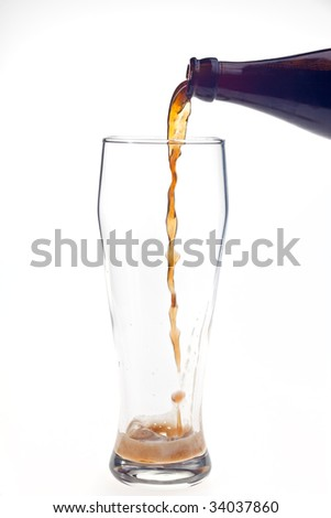 pouring dark wheat beer in a glass