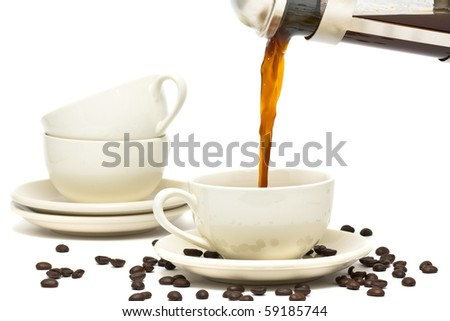 Pouring fresh brewed coffee into ceramic cup