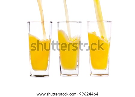Pouring glass of juice. Half of the glass, shot on white background