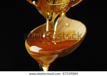 Pouring Maple Syrup over a Spoon