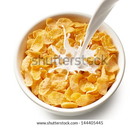 pouring milk into bowl of corn flakes, top view #144405445
