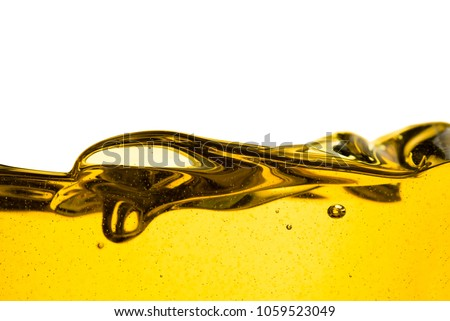 Pouring oil car motor or olive vegetable cooking and bubble isolated on white background