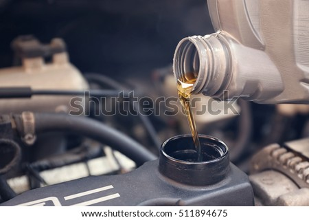 Pouring oil to car engine, close up #511894675