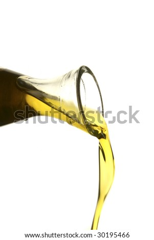 pouring olive oil from a bottle - stock photo