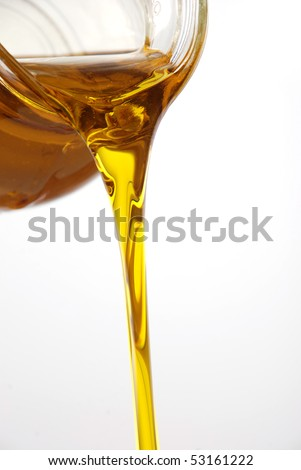 Pouring olive oil from a bottle