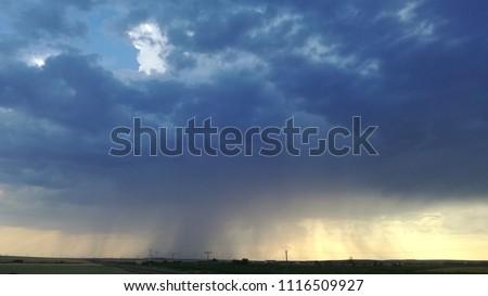 Pouring rain. Storm. Rain. Dark blue. Clouds. Overcast. Overcast weather.