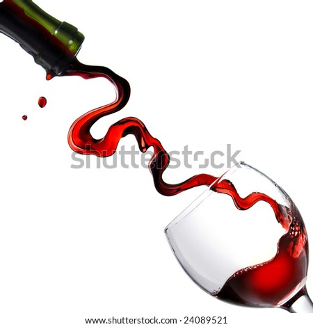 Pouring red wine in glass goblet isolated on white - stock photo