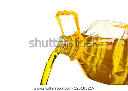 pouring the oil isolated on white background