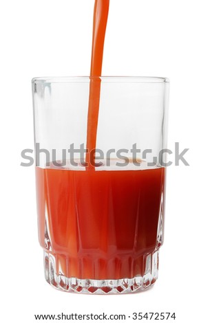 pouring tomato juice in a glass, isolated on white