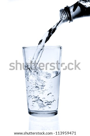 Pouring water into glass (splash of water) isolated on white