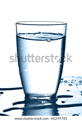 pouring water on a glass on white background