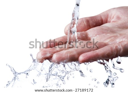 Pouring water splashing on hand close up