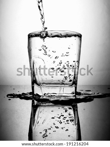 pouring water to glass ストックフォト ©