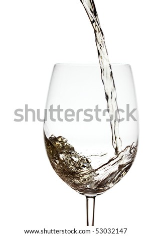 Pouring white wine into a glass over white background