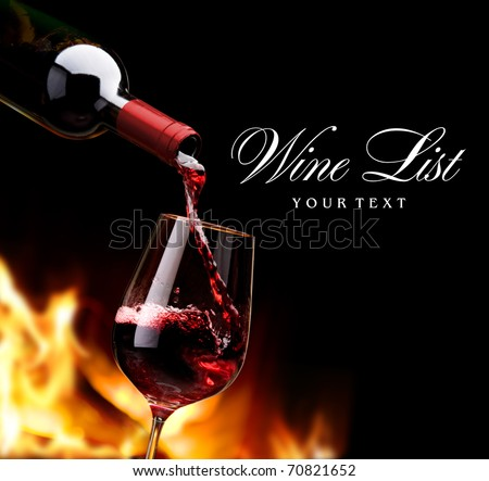 pouring wine by the fireplace