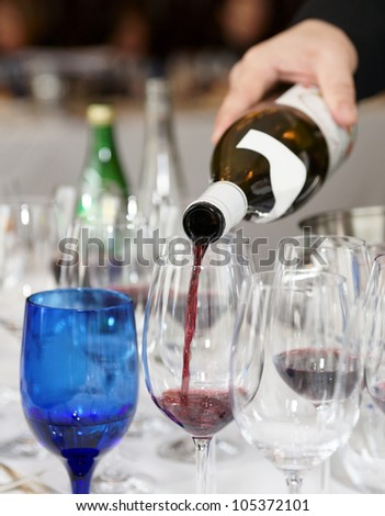 Pouring wine during a winetasting event