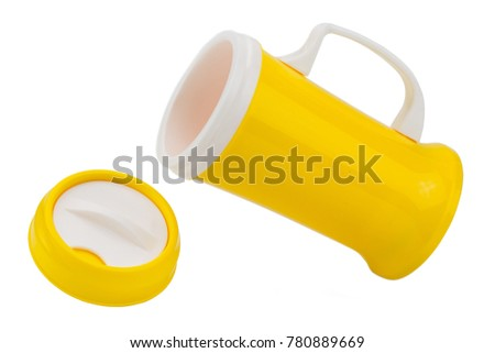 Pouring yellow plastic tumbler thermos cup with handel isolaoted on white background
