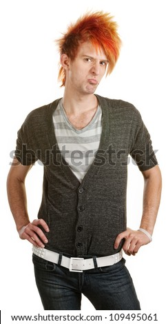 Pouting male Caucasian teenager with hands on hips