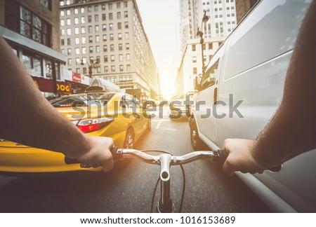 Shutterstock Pov bicycle view camera in New york city, traffic jam