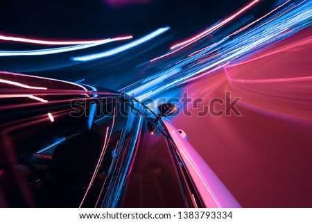 POV of car driving at night city with motion blur effect. Transportation and traffic concept #1383793334