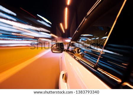 POV of car driving at night city with motion blur effect. Transportation and traffic concept #1383793340