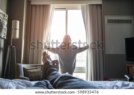 Shutterstock Pov style - young couple of travelers enjoying the morning view.