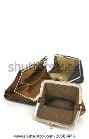 Poverty. Group of empty worn-out purses isolated on white with shadow.