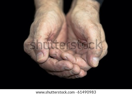 Poverty. Old hands on black with clipping path
