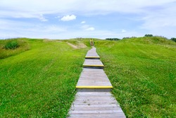 Poverty Point World Heritage Site in Louisiana is a prehistoric monumental earthworks site constructed by the Poverty Point culture. Boardwalk stairs climbing the largest earthen mound - Mound A.