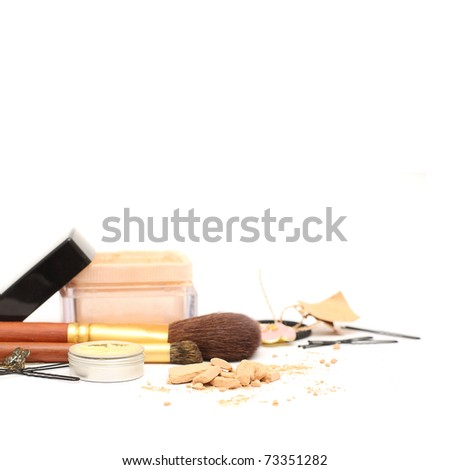 Powder and women accessories: cosmetic, jewelry, hairpins isolated. Shallow depth of field