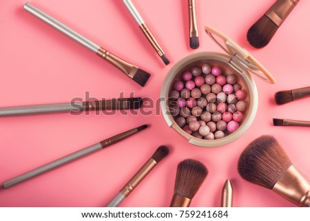Powder balls and cosmetic brush on pink background. beauty makeup product #759241684