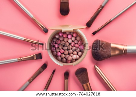 Powder balls and cosmetic brush on pink background. beauty makeup product #764027818