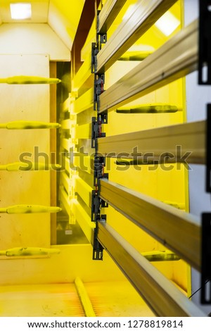 Powder coating line. Camera painting products in an electrostatic field. #1278819814