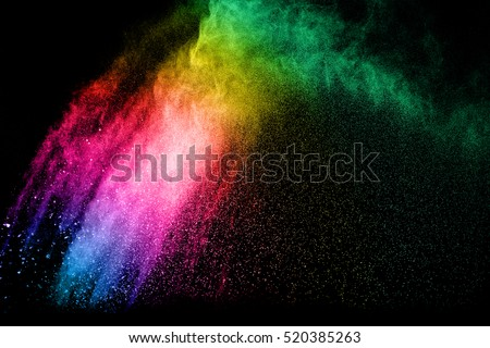 Shutterstock powder explosion on black background. Colored cloud. Colorful dust explode. Paint Holi.