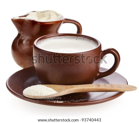 powder milk in  clay  pitcher and cup on white background
