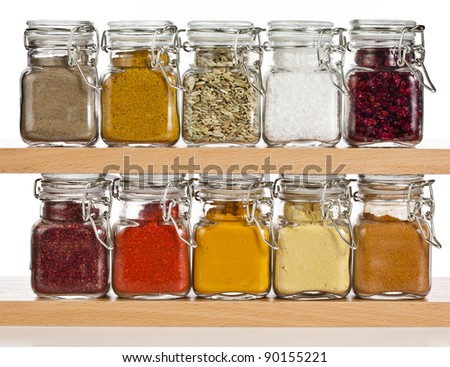 powder spices  in glass bottle isolated on white background