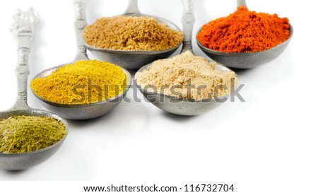 Powder spices isolated on white